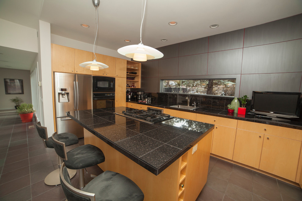Granite tiles on kitchen island countertop