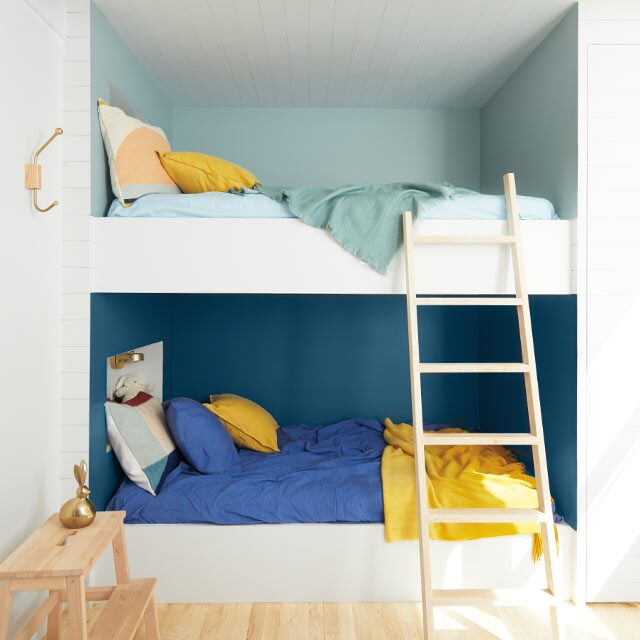 A bunk bed alcove with two-tone blue walls